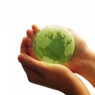Photo of hands holding the Earth